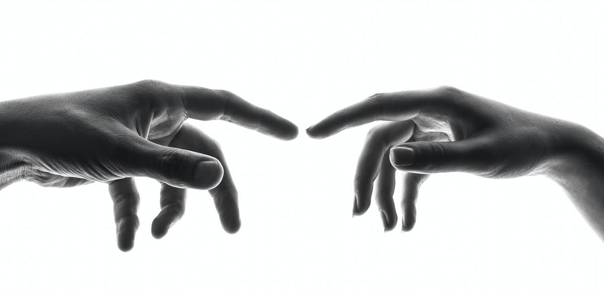 two person's connecting fingers